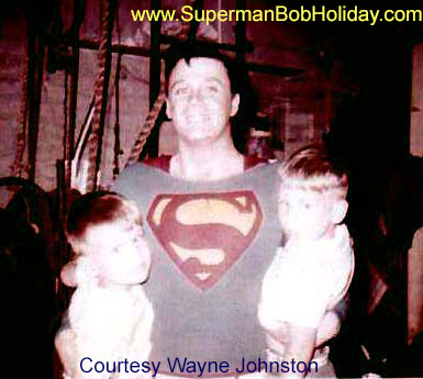 Bob Holiday holding young Wayne and Warren Johnston